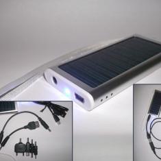 Incarcator solar cu baterie interna 1350mAH pentru telefoane mobile, camere foto, pda-uri, mp3 playere