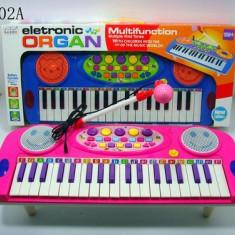 Instrumente muzicale copii - Orga electronica de jucarie / Orga pentru fetite cu microfon si lumini