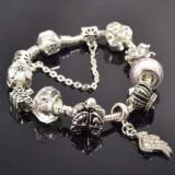 Bratara PANDORA cu charmuri caleasca, aripa inger, coroana, dedicatie