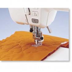 Piciorus pentru acoperirea rupturilor de material (stopare), matlasare cu linii curbe sau broderie manuala